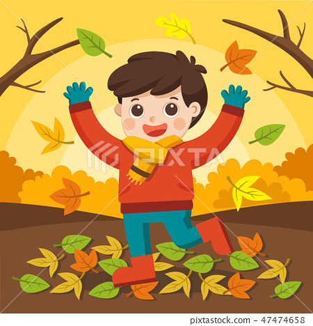 Boy laughing and playing in the autumn. 47474658
