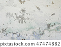 Old painted cement wall with all the cracks  47474882