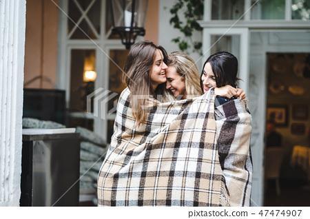 Three girlfriends on the veranda 47474907