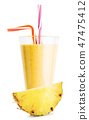 A glass of pineapple smoothie or yogurt with pineapple slice 47475412