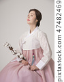 Korean beauty concept photo. Young beautiful woman wearing Hanbok, Korean traditional dress. 016 47482469