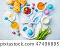 Easter Breakfast table. Colored eggs, bun, juice 47496895