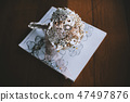 Handmade brooch bouquet on the white book 47497876