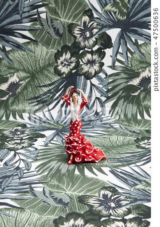 flamenco dancer figurine tropical motif background 47500636