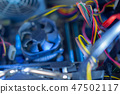 PC components in dust. Dusty power wires, CPU fan soft focus 47502117