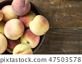 ripe peaches on a wooden background 47503578