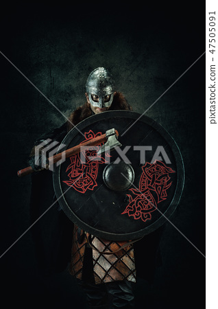 Portrait of a Viking holding a sword and a shield  47505091