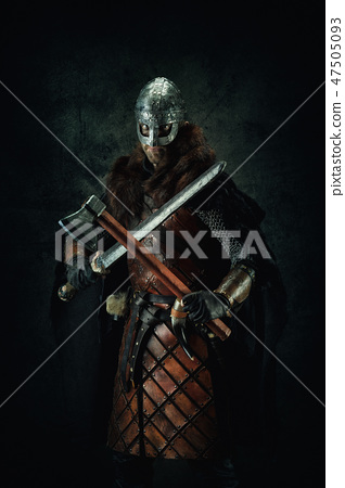 Portrait of a Viking holding a sword and an ax  47505093