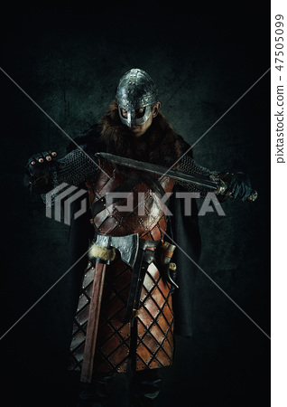 Portrait of a Viking holding a sword in his hand 47505099