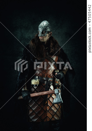Portrait of a Viking holding an ax in his hand 47505442