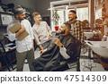 Friends have fun in barbershop 47514309