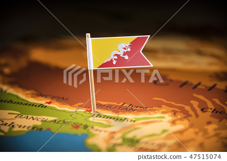 Bhutan marked with a flag on the map 47515074