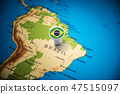 Brazil marked with a flag on the map 47515097