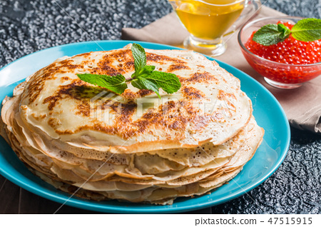 Stack of yeast pancakes 47515915