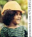 Happy little boy engineer wearing helmet hard hat. 47518951