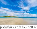 Idyllic white sand beach blue sky with island 47522032