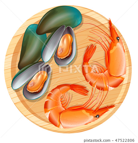 Seafood on wooden plate 47522806
