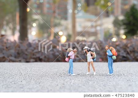 Mini of  Traveler with back pack walking 47523840