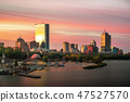 Sunrise over Boston city with boat and harbor 47527570