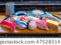 Sushi set on wooded plate in Japanese seafood  47528314