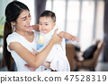 Asian mother and her baby play togather 47528319