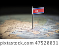 North Korea marked with a flag on the map 47528831