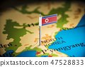 North Korea marked with a flag on the map 47528833