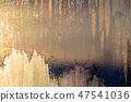 Sunset the sun shines through the frozen window 47541036