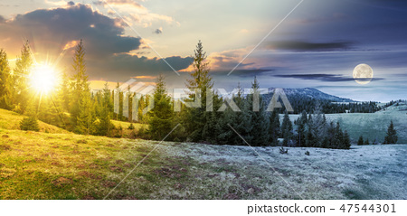 time change in mountainous countryside in spring 47544301