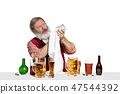 Expert barman with beer at studio 47544392