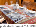 Table served with dishes, close up 47546090