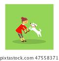 ผู้หญิงกำลังเล่นกับสุนัข 1 47558371