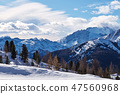 Dolomite mountains covered in snow at sunset 47560968