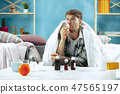 Bearded sick man with flue sitting on sofa at home. Illness, influenza, pain concept. Relaxation at 47565197