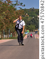 Young business man going to work with inline skate 47570842