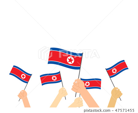 Hand holding North Korea flags 47571455
