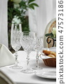 crystal glasses on the table in the restaurant table setting 47573186