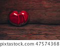 Glass red heart on a old wooden table background. 47574368