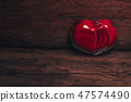 Glass red heart on a old wooden table background. 47574490