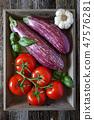 Raw graffiti eggplants, garlic, tomatoes 47576281