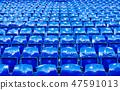 Many bright blue stadium seats perspective shot 47591013