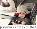 Baby girl in stroller 47603644