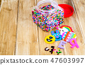 Jar with colored plastic pieces of children mosaic 47603997