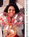 Happy positive woman holding beautiful colorful balloons 47606070