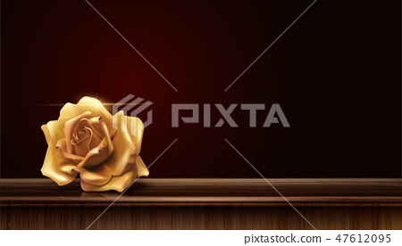 Golden rose on wood table 47612095