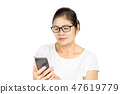 old woman using smart phone for social media 47619779