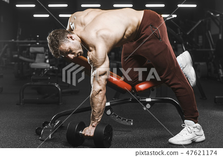 Handsome strong athletic men pumping up muscles workout bodybuil 47621174