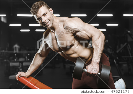 Handsome strong athletic men pumping up muscles workout bodybuil 47621175