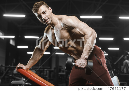 Handsome strong athletic men pumping up muscles workout bodybuil 47621177