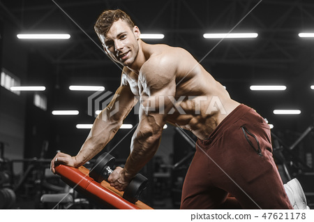 Handsome strong athletic men pumping up muscles workout bodybuil 47621178